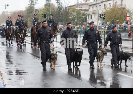 European street, Prague-October 28, 2018: Police workers with service dogs are marching on military parade for 100th anniversary of creation Czechoslo - Stock Photo