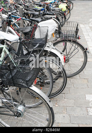Lucerne, LU / Switzerland - November 9, 2018: many different makes and types of bicycles crowd the bicycle parking lot at Lucerne train station where - Stock Photo