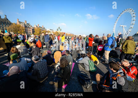 Westminster Bridge, London, UK. Organised by Extinction Rebellion, a protest is underway to 'rebel against the British Government for criminal inaction in the face of climate change catastrophe and ecological collapse'. Protesters are blocking the Thames bridges of Westminster, Waterloo, Southwark, Blackfriars and Lambeth thereby disrupting traffic - Stock Photo