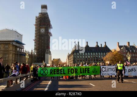 London, UK. 17th November 2018. Extinction Rebellion occupy Westminster Bridge in protest over climate change. Credit: Dimple Patel/Alamy Live News - Stock Photo