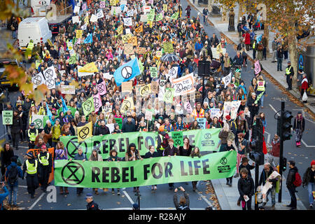 London, UK. - November 17, 2018: Extinction Rebellion climate change protestors marching along London's Embankment. - Stock Photo