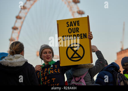 London, UK. - November 17, 2018: A protestor holds a banner on Westminster Bridge during the Extinction Rebellion Climate March. Credit: Kevin J. Frost/Alamy Live News - Stock Photo