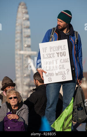 London, UK. 17th November, 2018. Environmental campaigners from Extinction Rebellion block Lambeth Bridge, one of five bridges blocked in central London, as part of a Rebellion Day event to highlight 'criminal inaction in the face of climate change catastrophe and ecological collapse' by the UK Government as part of a programme of civil disobedience during which scores of campaigners have been arrested. Credit: Mark Kerrison/Alamy Live News - Stock Photo