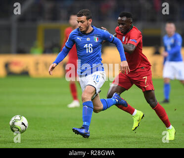 Milan, Italy. 17th Nov, 2018. Italy's Alessandro Florenzi (L) vies with Portugal's Bruma during the UEFA Nations League soccer match between Italy and Portugal in Milan, Italy, Nov. 17, 2018. The match ended with a 0-0 draw. Credit: Alberto Lingria/Xinhua/Alamy Live News - Stock Photo