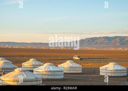 Morning scenic view of Khongoryn Els sand dunes from a tourist ger camp in the Gobi desert. - Stock Photo