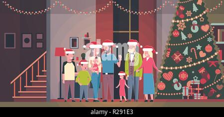 multi generation family standing together in house near decorated fir tree happy new year merry christmas concept flat horizontal - Stock Photo