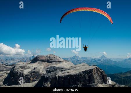 Paragliding, Dolomites, Sella Group, Sass Pordoi, Piz Boe, Fassa Valley, aerial photo, Trentino region, Canazei, Campitello - Stock Photo