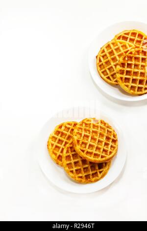 Pumpkin cornbread waffles isolated on white - Stock Photo