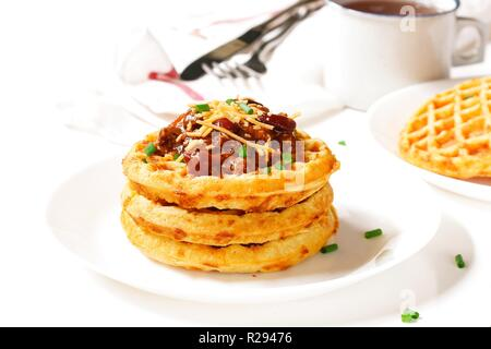 Homemade Cheddar Cornbread Waffles served with Chili /Thanksgiving breakfast on white background - Stock Photo