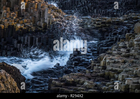 Landscape around Giant`s Causeway, A UNESCO world heritage site which has numbers of interlocking basalt columns result of an ancient volcanic fissure - Stock Photo