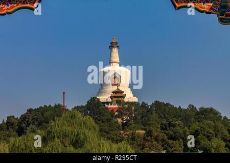 The Jade Island with Bai Ta (White Pagoda or Dagoba) stupa in Buddhist Yong An Temple of Everlasting Peace in Beihai Lake Park  in Beijing, China - Stock Photo
