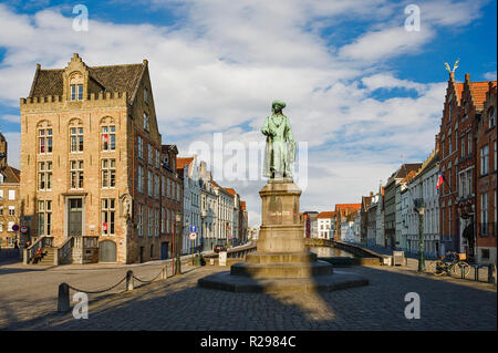 Bruges, Belgium, Standing in the middle of the square the renowned Bruges painter Jan van Eyck  proudly overlooks the domain that wears his name. - Stock Photo