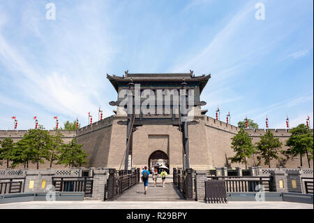 Xi'an, Shaanxi province, China - Aug 9, 2018 : Tourists walking by the Xi'an city wall south gate - YongNingMen on a sunny day in summer. - Stock Photo