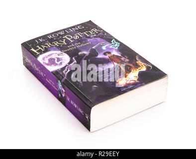 SWINDON, UK - NOVEMBER 18, 2018: Harry Potter And The Deathly Hallows Paperback Edition on a white background - Stock Photo