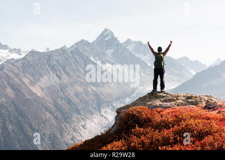 Amazing view on Monte Bianco mountains range with tourist on a foreground. Vallon de Berard Nature Preserve, Chamonix, Graian Alps. - Stock Photo