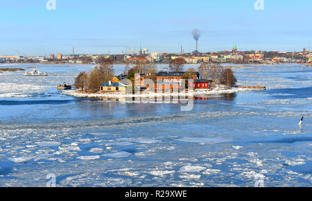 Baltic Sea with ice floes on background of Helsinki on sunny day. Finland - Stock Photo