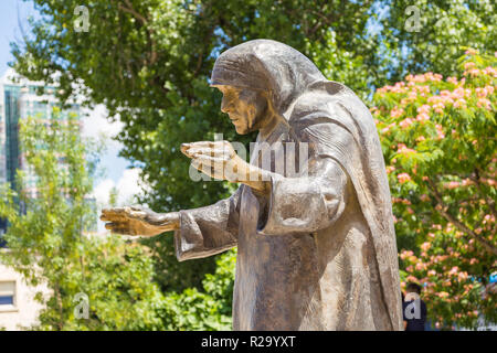 Tirana, Albania- 01 July 2014: Monument to Mother Teresa in the center of Tirana. Saint Mother Teresa of Calcutta, an Albanian nun. - Stock Photo