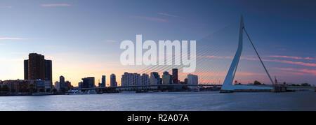 Erasmus Bridge (Erasmusbrug) and skyline at sunset, Rotterdam, Zuid Holland, Netherlands - Stock Photo