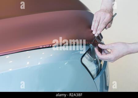 pasting of car carbonic plastic closeup - Stock Photo