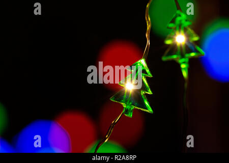 Christmas decorations and colored blurred lights on the background. - Stock Photo