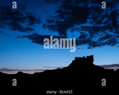 Seven Sailors formation at dusk, Valley of the Gods west of Bluff, Utah. - Stock Photo