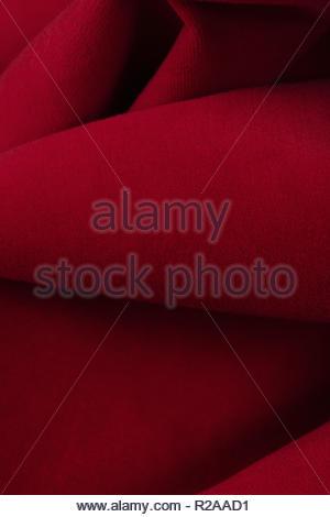 Defocused background image of red velvet fabric. - Stock Photo