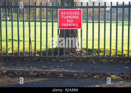No vehicles allowed turning or parking sign at road - Stock Photo