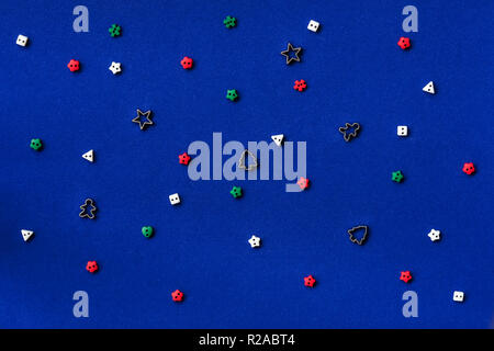 Christmas pattern made of several different traditional forms on blue background. Flat lay, top view - Stock Photo