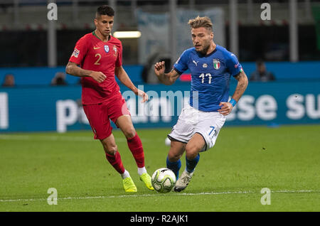 Milan, Italy. 17th Nov, 2018. Ciro Immobile (Italy) and João Cancelo (Portugal) during the UEFA Nations League 2018, League A, Group 3 football match between Italy and Portugal on November 17, 2018 at Giuseppe Meazza stadium in Milan, Italy - Photo Laurent Lairys / DPPI Credit: Laurent Lairys/Agence Locevaphotos/Alamy Live News - Stock Photo