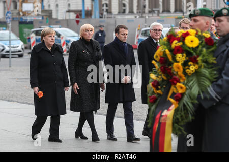 Berlin, Germany. 18th Nov 2018. French President Emmanuel Macron (3rd L), German Chancellor Angela Merkel (1st L) and German President Frank-Walter Steinmeier (4th L) attend a wreath-laying ceremony at Neue Wache memorial in Berlin, capital of Germany, on Nov. 18, 2018. Visiting French President Emmanuel Macron on Sunday addressed German legislators, calling for opening a new chapter for Europe and building it more integrated, stronger and independent.   - Stock Photo