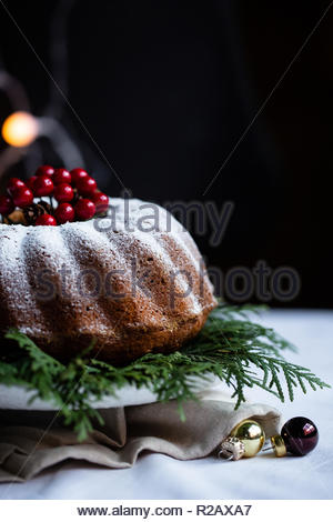 Home made christmas pie with chocolate and cranberries. Decorated with Christmas lights and christmas balls. Marry Christmas and happy new year. - Stock Photo