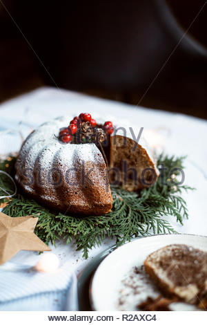 Christmas chocolate cake, pudding on white table with christmas decoration. Copy space. View from the top. - Stock Photo