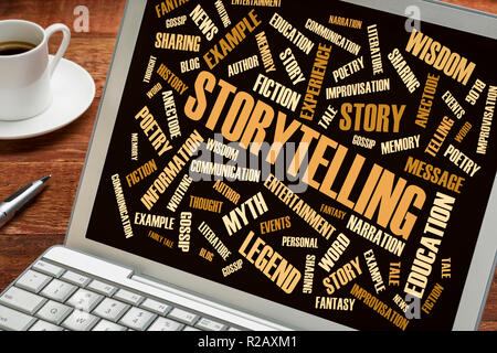 storytelling word cloud on a laptop with a cup of coffee - Stock Photo