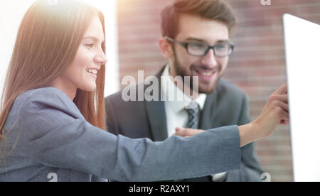 colleagues discussing information on a computer - Stock Photo
