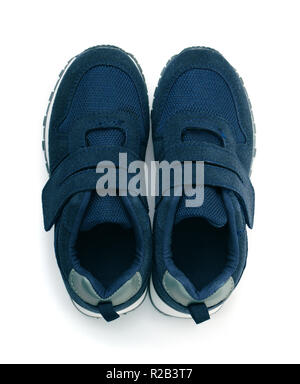 Top view of blue suede sport shoes isolated on white - Stock Photo