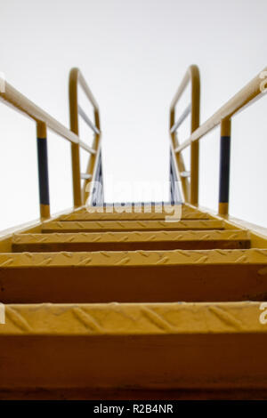 metal steps of a playground slide UK - Stock Photo