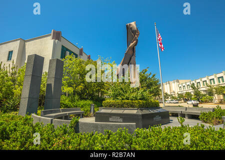 Los Angeles, California, United States - August 6, 2018: Beverly Hills 9-11 Memorial Garden, a memorial space in honor of September 11 attacks. Beverly Hills Fire Department Headquarters on background - Stock Photo