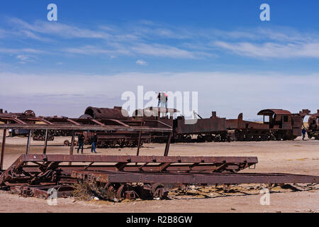 Antique train at the Train cementery in salar de Uyuni(Uyuni salt flat) Bolivia - Stock Photo