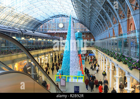 The Tiffany & Co's robot decorated Christmas tree in St Pancras International train station, in London, UK - Stock Photo