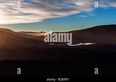Landscape of a sunrise at the geyser of Sol de Mañana, Bolivia - Stock Photo