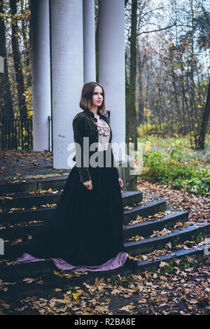 Woman in an old dress at the gazebo - Stock Photo