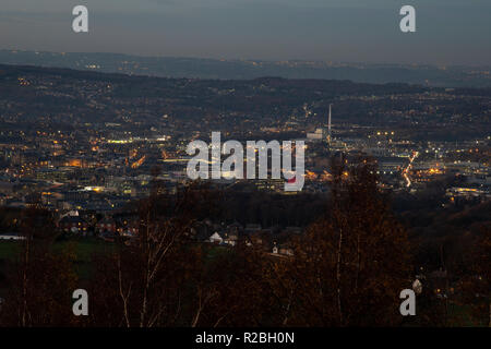 A view of Huddersfield Town Centre from Castle Hill at night with the town lit up - Stock Photo