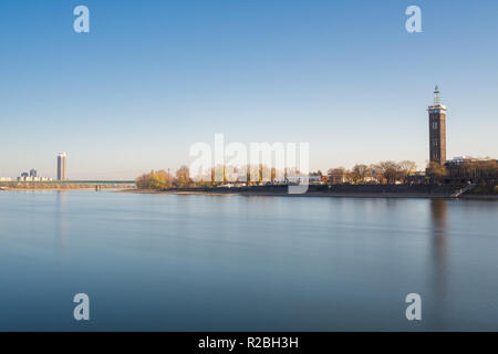 View of the Long River Rhine, the RTL Building, The Axa Building and the Mülheimer Bridge in Autumn in Germany Cologne 2018. - Stock Photo