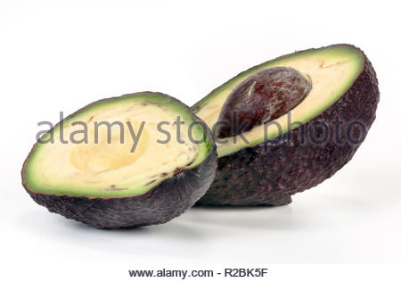 Halved Avocado with pip isolated on white background. - Stock Photo
