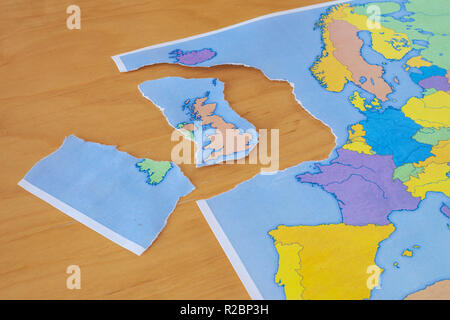a torn paper map symbolizing the UK leaving the European Union or Brexit - Stock Photo