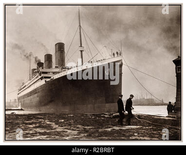 RMS TITANIC leaving Harland & Wolff shipyards April 2nd 1912 Sombre still dawn image of Titanic casting off on her fateful tragic maiden voyage - Stock Photo