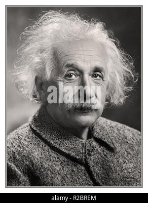 Albert Einstein theoretical physicist.  Albert Einstein was a German-born theoretical physicist who developed the theory of relativity, one of the two pillars of modern physics. His work is also known for its influence on the philosophy of science. Digitally enhanced image to produce original 1940's studio impact and quality. - Stock Photo