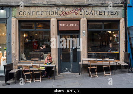 The Milkman, a coffee shop on Cockburn Street in Edinburgh with the original 'Confections Snacks Cigarettes' sign painted on the wall - Stock Photo
