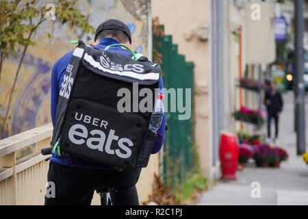 Uber Eats meal deliverer rides in Lyon, France - Stock Photo