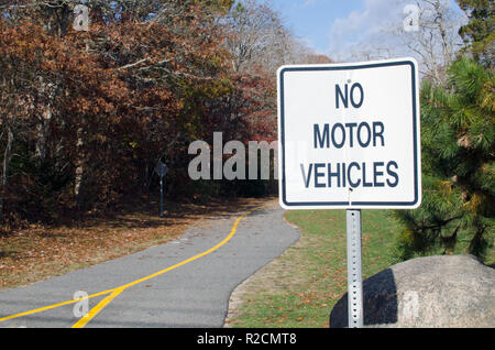 No Motor Vehicles sign on the paved Shining Sea Bikeway Falmouth, Cape Cod bike and walking path in late autumn - Stock Photo